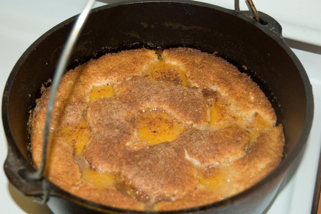 Dutch Oven Peach Cobbler Simple Recipe Barbequelovers Com
